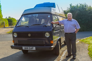 Brent Tanner standing next to his 'Club Joker' VW Camper Van